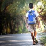 boy wearing a back pack